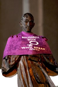 gandhi dressed in purple