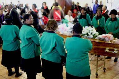 ANC women surrounding the coffin inside Church Hall