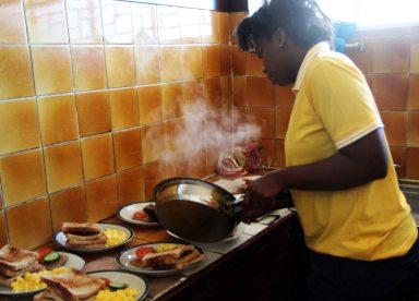 Zandile, our kitchen manager preparing breakfast.  Photo by Collen