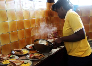 Zandile, our kitchen manager preparing breakfast.  Photo by Collen