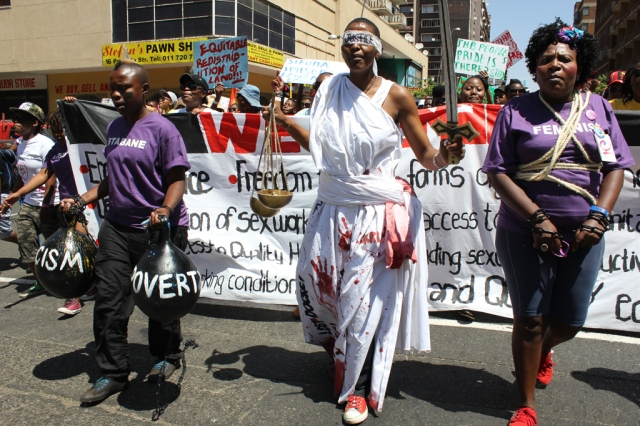 Our activist and performing artist, Thokozani Ndaba leading Johannesburg People's Pride as Raped Lady Justice. © Collen Mfazwe & Xana Nyilenda
