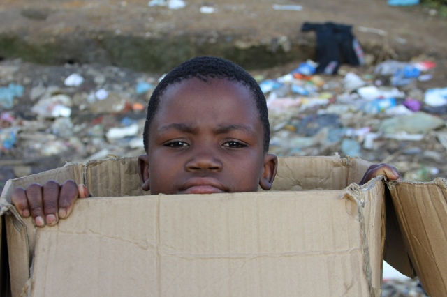 boy playing with trash_0690