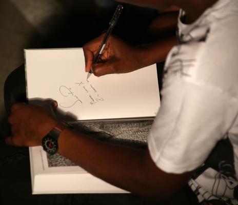 2014 Nov. 7 Muholi signing book for SlyPod_5517