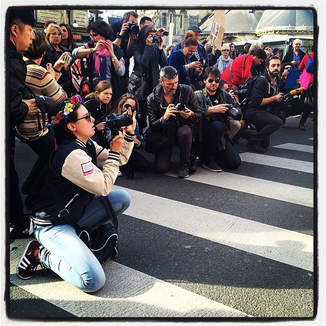 male photographers on intl women s day march in paris