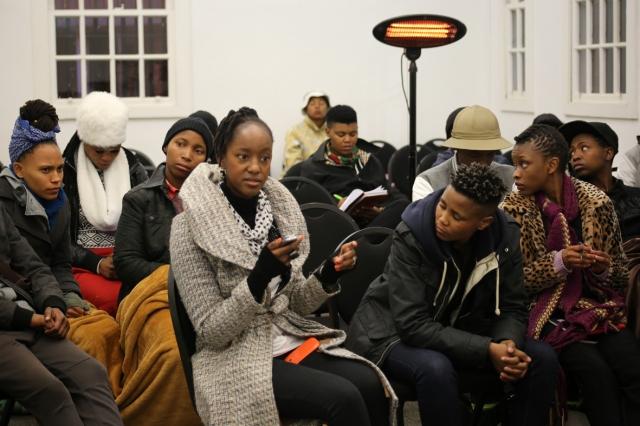 Motivational speaker Kea addressing youth at Yithi Laba conference.