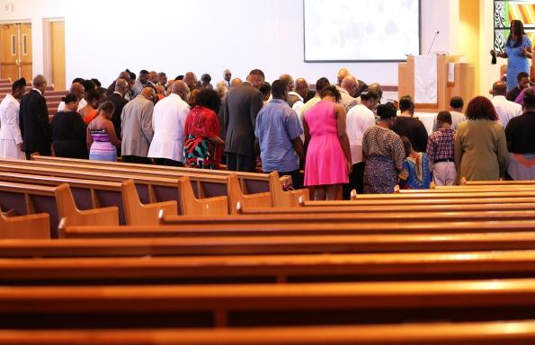 2015 Aug. 9 BBC congregants praying_0637