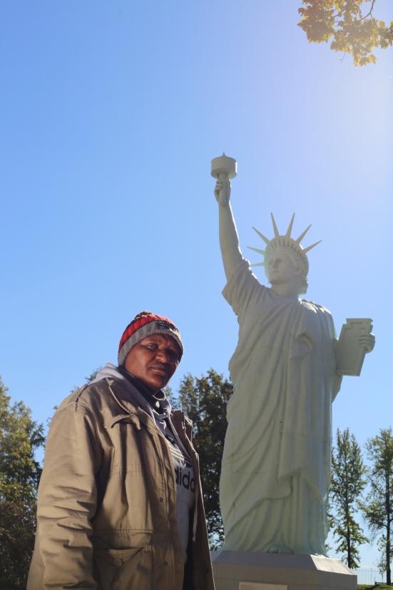2015 Oct. 20 Funeka next to Statue of Liberty_7459